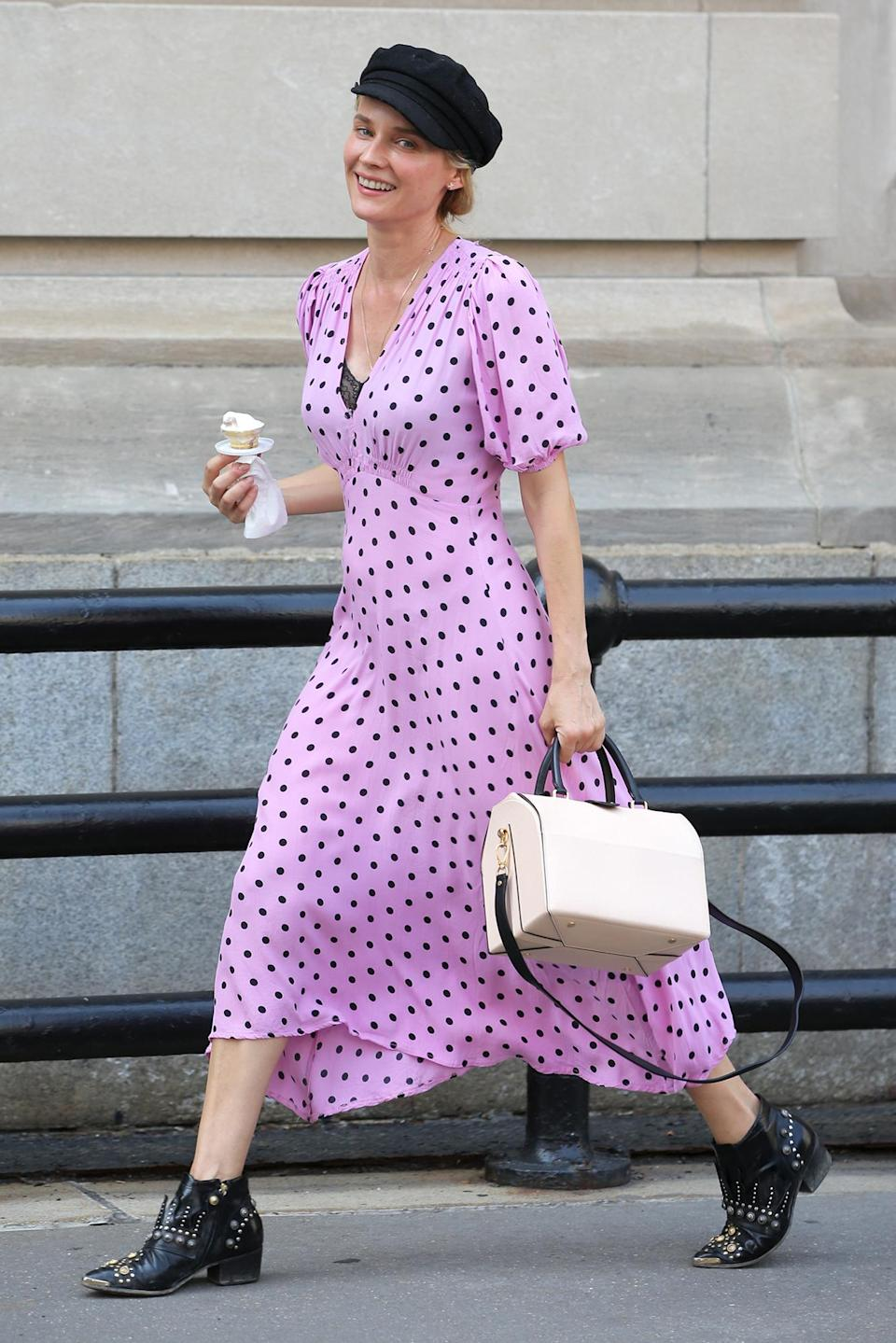 <p>Diane Kruger sports a purple polka dot dress while enjoying some ice cream on a hot day in N.Y.C. on June 21.</p>