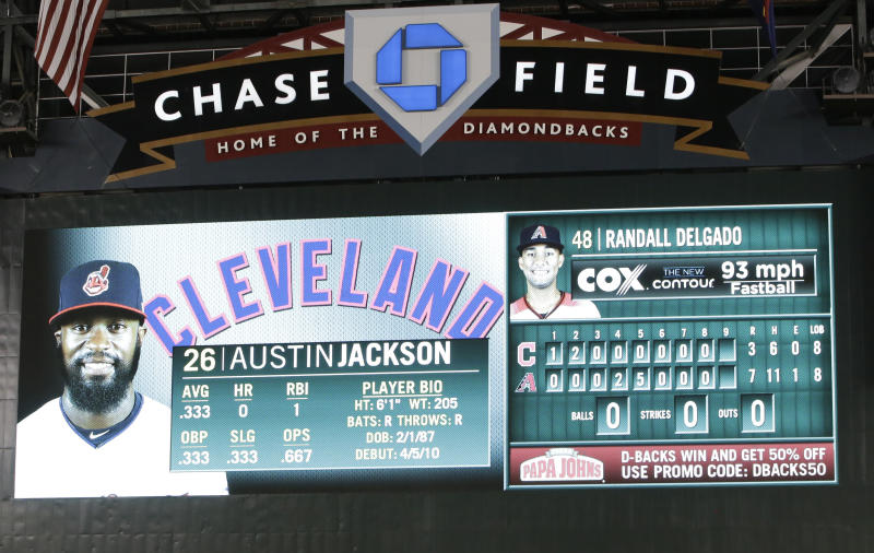 The scoreboard displays a speed, upper right, on pitch by Arizona Diamondbacks' Randall Delgado to Cleveland Indians' Austin Jackson during the ninth inning of a baseball game Friday, April 7, 2017, in Phoenix. From watching broadcasts and scoreboards, fans are seeing velocities ramp up around the majors this year. Check the leaderboards at analytics website Fangraphs, and you'll see that last April, pitchers averaged 92.2 mph on four-seam fastballs. Through Thursday's games this season, they're up to 93.1 mph, an unprecedented jump. Did some 300 pitchers all find ways to boost their speed in the offseason? Not quite. More likely, the perceived speed spike is coming from a change in how pitches are being recorded and reported. (AP Photo/Rick Scuteri)