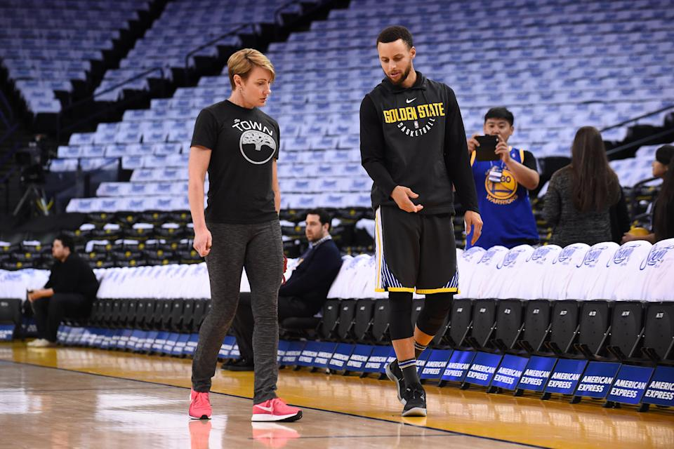 Steph Curry with trainer Chelsea Lane, who gets all credit for rehabbing Curry's recent injuries. (Getty)