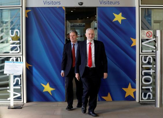 Jeremy Corbyn and Keir Starmer leave the European Commission headquarters in Brussels after a meeting (Reuters)