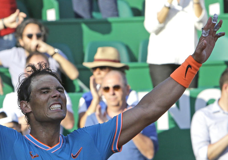 Spain's Rafael Nadal grimaces as he defeats Argentina's Guido Pella during their quarterfinal match of the Monte Carlo Tennis Masters tournament in Monaco, Friday, April 19, 2019. (AP Photo/Claude Paris)