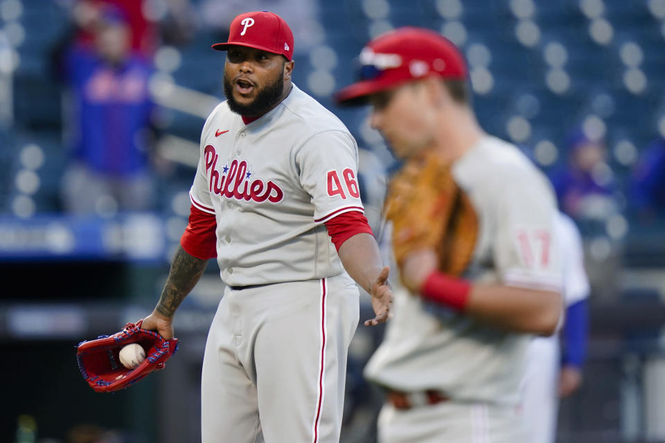 Philadelphia Phillies relief pitcher Jose Alvarado (46) talks to the New York Mets bench after hitting Michael Conforto with a pitch during the sixth inning in the first game of a baseball doubleheader Tuesday, April 13, 2021, in New York. (AP Photo/Frank Franklin II)