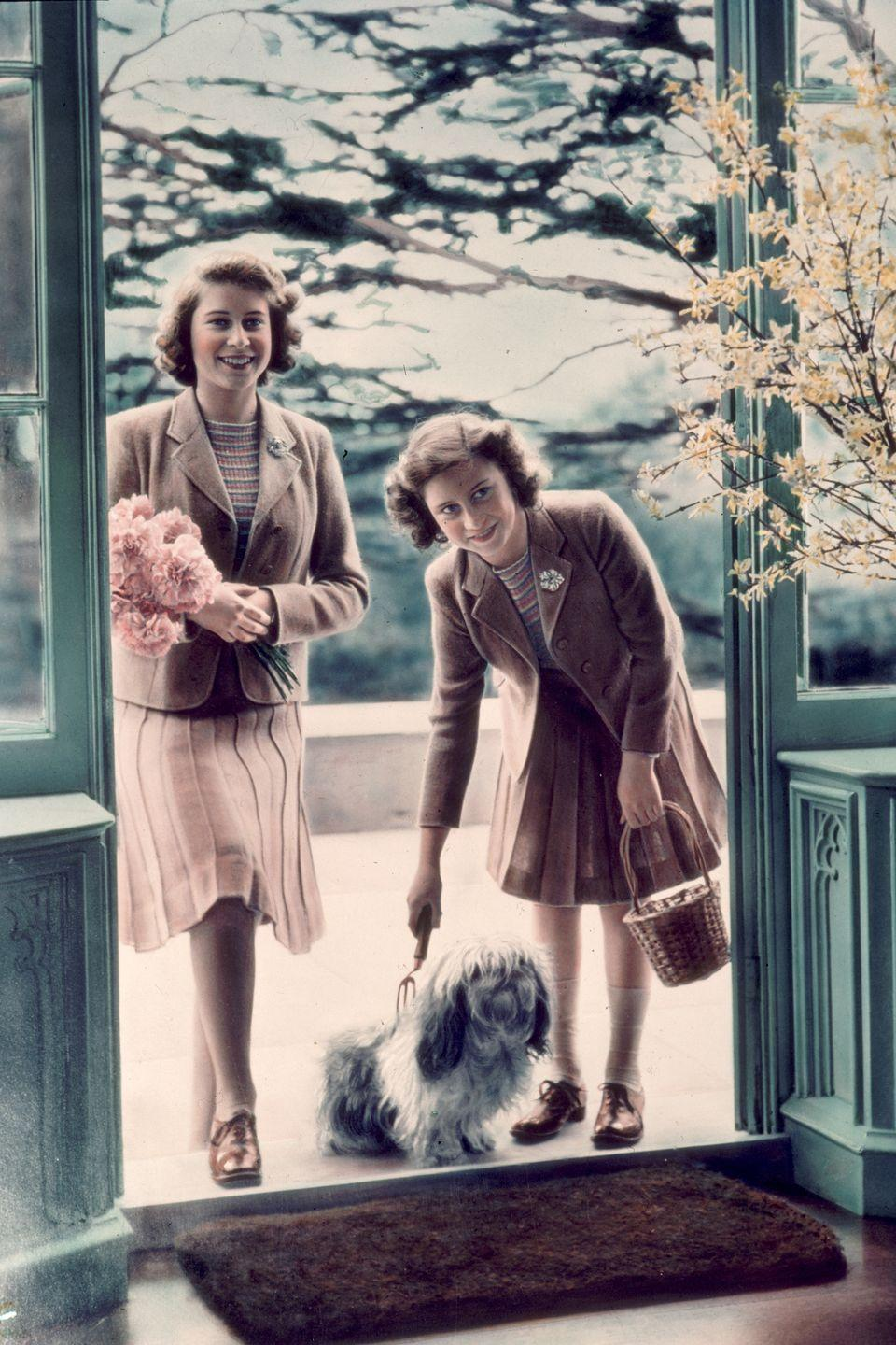 <p>Here she is with her sister Princess Margaret (right) and an adorable lhaso apso pup at the Royal Lodge in Windsor.<br></p>