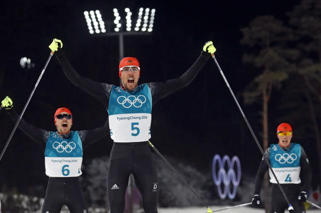 Nordic Combined Events - Pyeongchang 2018 Winter Olympics - Men's Individual 10 km Final - Alpensia Cross-Country Skiing Centre - Pyeongchang, South Korea - February 20, 2018 - Johannes Rydzek of Germany, Fabian Riessle of Germany and Eric Frenzel of Germany react as they cross the finish line. REUTERS/Kai Pfaffenbach
