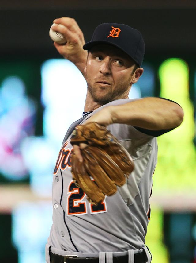 Detroit Tigers shortstop Andrew Romine pitches in relief in the eighth inning of a baseball game against the Minnesota Twins, Friday, Aug. 22, 2014, in Minneapolis. Romine gave up two home runs in the inning. The Twins won 20-6. (AP Photo/Jim Mone)