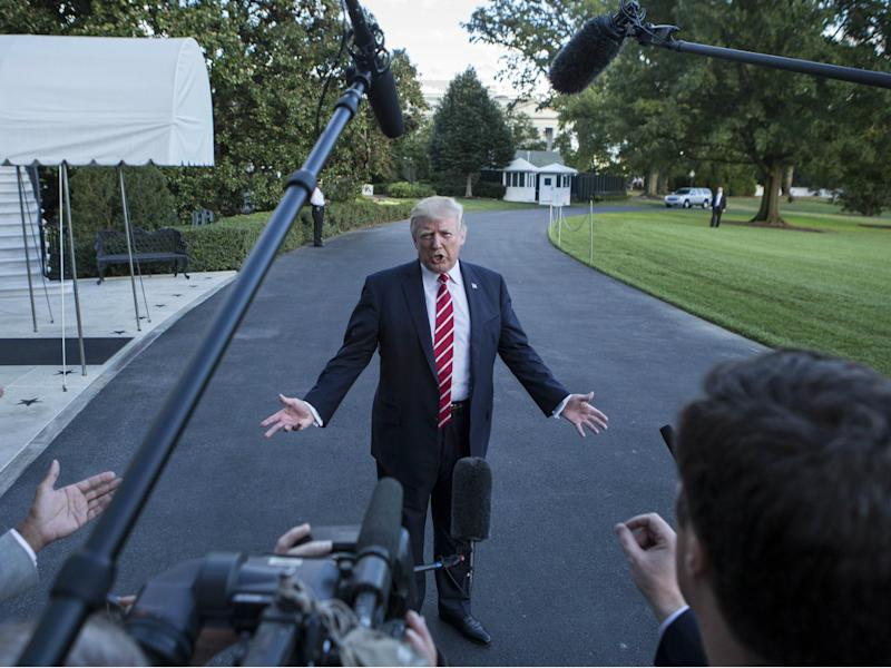 Donald Trump speaks to reporters outside the White House: ALEX EDELMAN/AFP/Getty Images