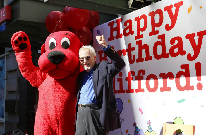 This image released by Scholastic shows Norman Bridwell, creator of Clifford the Big Red Dog, celebrating the character's 50th anniversary at Scholastic's headquarters in New York, Monday, Sept. 24, 2012. (AP Photo/Scholastic, Stuart Ramson)