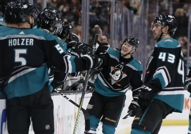Anaheim Ducks right wing Daniel Sprong, second from right, of the Netherlands, celebrates his goal against the Los Angeles Kings with teammates during the first period of an NHL hockey game in Anaheim, Calif., Sunday, March 10, 2019. (AP Photo/Alex Gallardo)