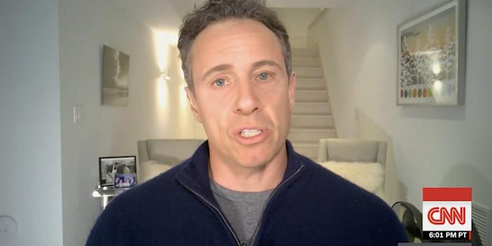 The CNN anchor Chris Cuomo seen hosting his show from his basement on Tuesday night after testing positive for the novel coronavirus.