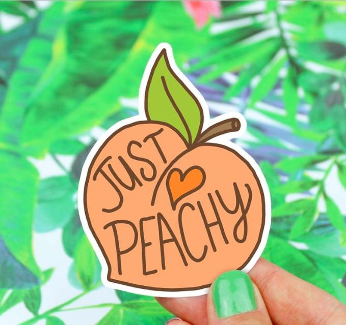 "<p>Peach perfection is always on the menu when you have this <a href=""https://www.popsugar.com/buy/Just-Peachy-Vinyl-Sticker-493917?p_name=Just%20Peachy%20Vinyl%20Sticker&retailer=etsy.com&pid=493917&price=3&evar1=geek%3Aus&evar9=46671902&evar98=https%3A%2F%2Fwww.popsugar.com%2Fnews%2Fphoto-gallery%2F46671902%2Fimage%2F46672432%2FJust-Peachy-Vinyl-Sticker&list1=tech%20accessories&prop13=api&pdata=1"" rel=""nofollow"" data-shoppable-link=""1"" target=""_blank"" class=""ga-track"" data-ga-category=""Related"" data-ga-label=""http://www.etsy.com/listing/544745168/peach-sticker-stickers-just-peachy-vinyl"" data-ga-action=""In-Line Links"">Just Peachy Vinyl Sticker</a> ($3, originally $4) on your laptop.</p>"