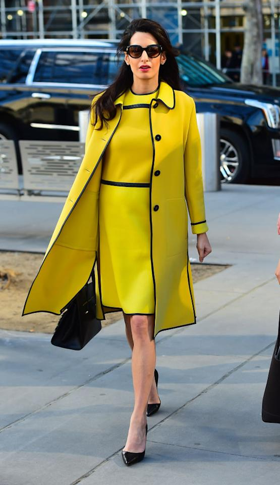 <p>Look out Kate Middleton, Amal had maternity style nailed when expecting twins earlier this year. Our favourite look? The human rights lawyer never shys from colour and here, was photographed in a mustard-hued Bottega Veneta shift dress and co-ordinating coat. <em>[Photo: Getty]</em> </p>