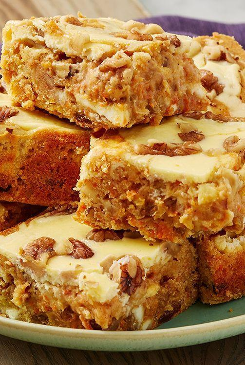 """<p>All your favourite <a href=""""https://www.delish.com/uk/cooking/recipes/a28826709/carrot-cake-banana-bread-recipe/"""" rel=""""nofollow noopener"""" target=""""_blank"""" data-ylk=""""slk:carrot cake"""" class=""""link rapid-noclick-resp"""">carrot cake</a> flavours transformed into one delectable <a href=""""https://www.delish.com/uk/cooking/recipes/a30713621/reeses-peanut-butter-blondies-recipe/"""" rel=""""nofollow noopener"""" target=""""_blank"""" data-ylk=""""slk:blondie"""" class=""""link rapid-noclick-resp"""">blondie</a> complete with cream cheese swirl! If you're a carrot cake purist, you can leave out the walnuts and sultanas.</p><p>Get the <a href=""""https://www.delish.com/uk/cooking/recipes/a31190492/carrot-cake-blondies/"""" rel=""""nofollow noopener"""" target=""""_blank"""" data-ylk=""""slk:Carrot Cake Blondies"""" class=""""link rapid-noclick-resp"""">Carrot Cake Blondies</a> recipe.</p>"""