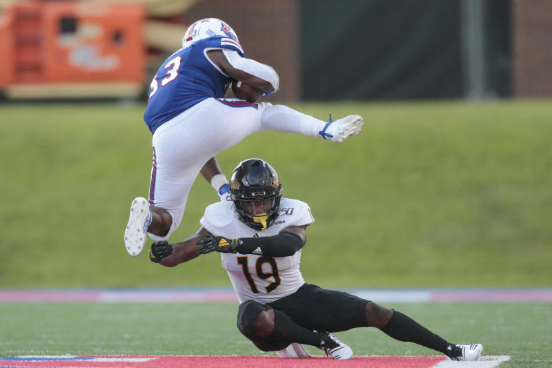 Justin Henderson hurdles a Southern Miss defender earlier this season. Henderson could top 1,000 rushing yards on the season Thursday. (Photo by Bobby McDuffie/Icon Sportswire via Getty Images)