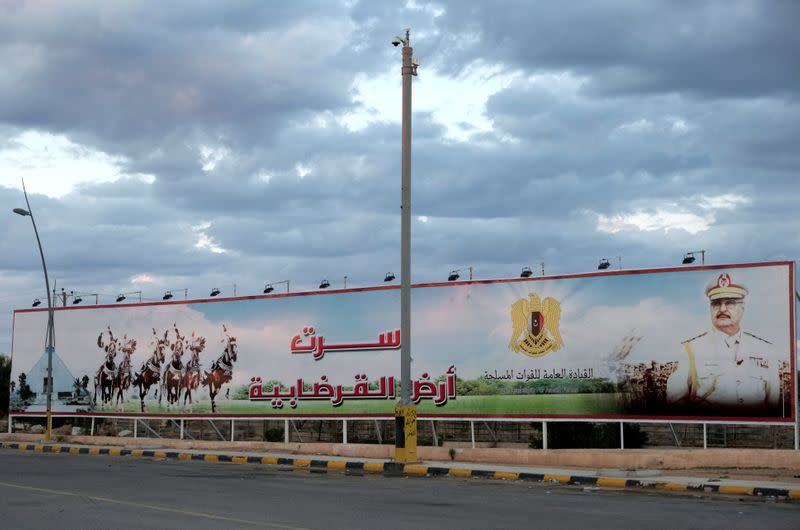A poster of the Libyan military commander Khalifa Haftar is seen at the entrance to the city in Sirte