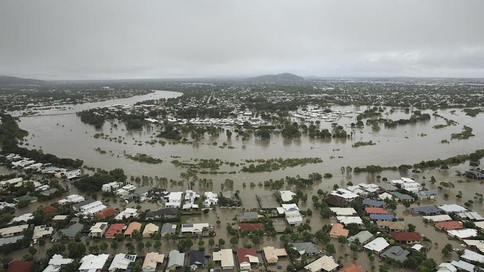 Townsville flooding: Two men missing as thousands evacuate