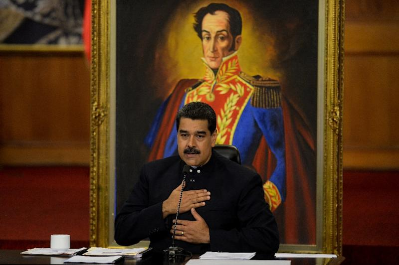 """President Nicolas Maduro insists Venezuela will never default on its debt but ratings agency Standard and Poors says the country is in """"selective default"""" (AFP Photo/FEDERICO PARRA)"""