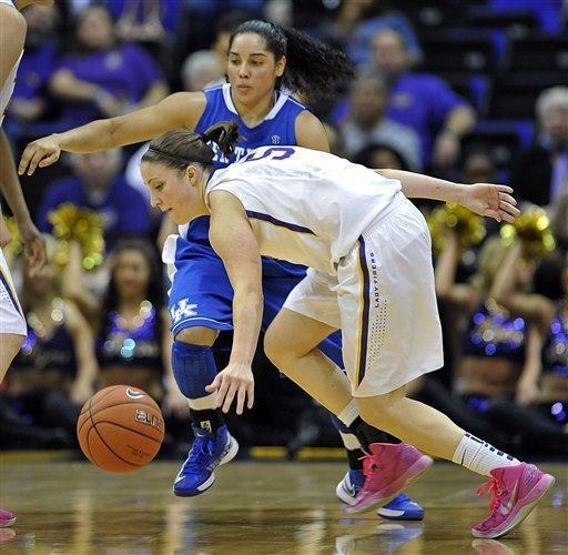 LSU guard Jeanne Kenney (5) chases down a loose ball in front of Kentucky guard Jennifer O'Neill, top, late in the second half of an NCAA college basketball game in Baton Rouge, La., Sunday, Feb. 24, 2013. LSU upset Kentucky 77-72. (AP Photo/Bill Feig)