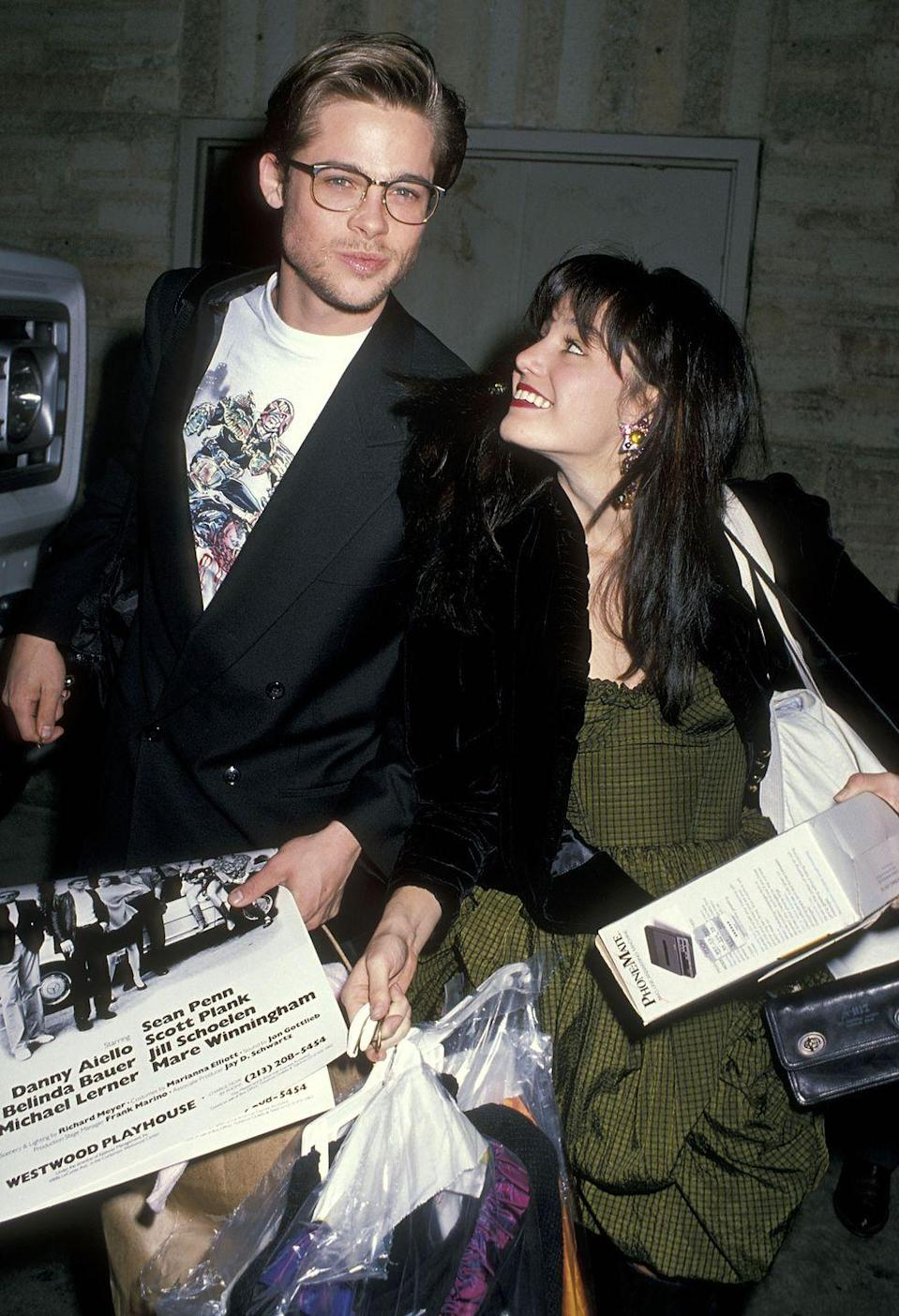 """<p>In 1989, Pitt and Schoelen got engaged, but it only lasted three months. In a <a href=""""https://www.ctvnews.ca/brad-pitt-recalls-being-dumped-by-ex-fiancee-jill-schoelen-1.633066"""" rel=""""nofollow noopener"""" target=""""_blank"""" data-ylk=""""slk:2011 interview"""" class=""""link rapid-noclick-resp"""">2011 interview</a>, Pitt revealed that he went to visit his then-fiancée in Budapest where she was filming a movie. When he got there, she revealed that she'd fallen in love with the director of her movie and the two called it quits. Pitt later said that Schoelen was his first big heartbreak. </p>"""