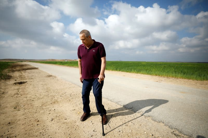 Gadi Yarkoni, now head of the Eshkol Regional Council, who lost his both legs by a mortar fired from Gaza during the Israel- Gaza war in 2014, walks next to his home near the border between Israel and the Gaza Strip