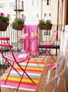 <p>Liven up even the smallest of patios with a bright pink furniture set and a trio of floral arrangements in the same color family.</p>