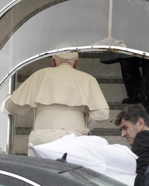 Pope Benedict XVI boards a plane to Lebanon accompanied by his butler Sandro Mariotti, bottom right, at the Ciampino military airport, on the outskirts of Rome, Friday, Sept. 14, 2012. The brutal civil war in Syria has given a sense of urgency to Pope Benedict XVI's trip this week to neighboring Lebanon, a mission he describes as a pilgrimage of peace for the entire region. And the Vatican stressed Benedict's push for dialogue among religions in the wake of the killing of the U.S. ambassador to Libya by a mob enraged by an anti-Muslim film, saying it is a message he will be taking to Lebanon. (AP Photo/Riccardo De Luca)