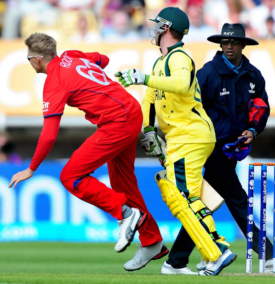 England's Joe Root (left) and Australia's Phillip Hughes clash during the ICC Champions Trophy match at Edgbaston, Birmingham.
