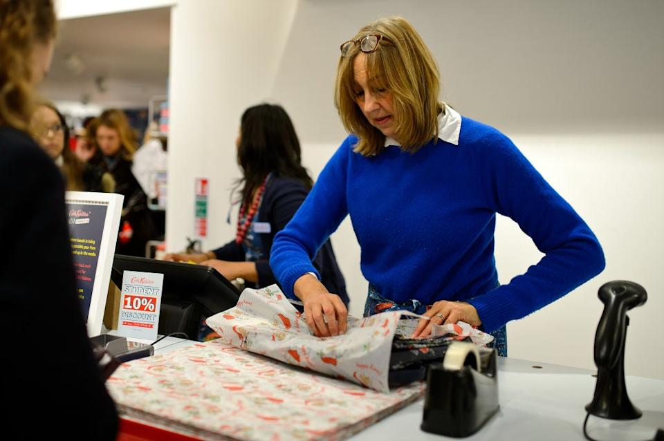 Cath Kidston helps wrap a productGetty for Cath Kidston