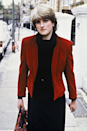 <p>Diana wore this polished ruby red blazer and black ensemble around Earl's Court prior to her engagement to Charles. </p>