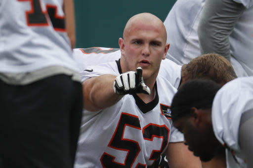 Cincinnati Bengals center Billy Price directs his teammates during practice at the NFL football team's training camp, Tuesday, June 12, 2018, in Cincinnati. (AP Photo/John Minchillo)