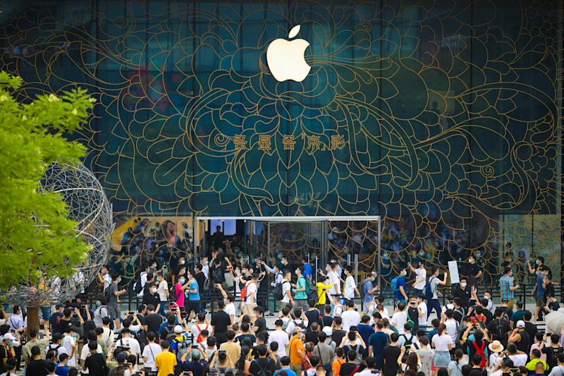 BEIJING, CHINA - JULY 17: People queue outside the Apple new flagship store at Sanlitun on July 17, 2020 in Beijing, China. (Photo by VCG/VCG via Getty Images)