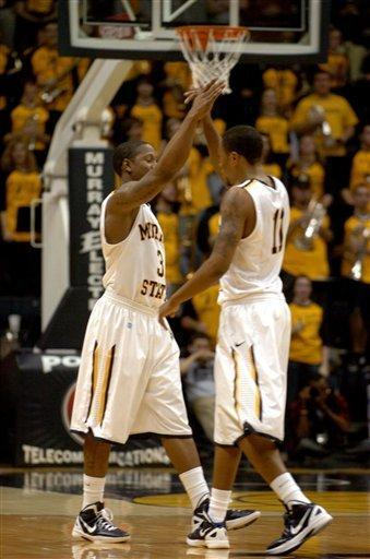 Murray State's Isaiah Canaan (3) and Donte Poole congratulate one another for a win against Eastern Kentucky as time runs out in the second half of an NCAA college basketball game on Wednesday, Jan. 4, 2012, in Murray, Ky. (AP Photo/Stephen Lance Dennee)