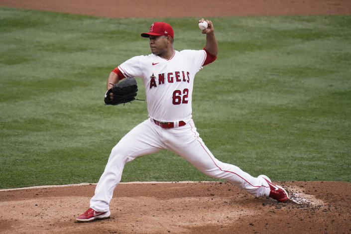 Los Angeles Angels starting pitcher Jose Quintana throws against the Texas Rangers during the first inning of a baseball game, Wednesday, April 21, 2021, in Anaheim, Calif. (AP Photo/Jae C. Hong)