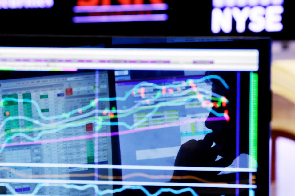 "FILE - In this Monday, Jan. 11, 2016, file photo, specialist Anthony Rinaldi is silhouetted on a screen at his post on the floor of the New York Stock Exchange. A smoother ride for stock investors sounds like a no-brainer given this year's big swings for the stock market, but the ""low-volatility"" funds pitched by the investment industry come with their own risks. (AP Photo/Richard Drew, File)"