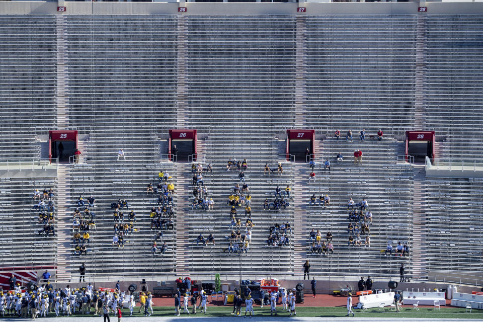 Michigan University fans watch during the first half of an NCAA college football game against Indiana at Memorial Stadium, Saturday, Nov. 7, 2020, in Bloomington, Ind. (AP Photo/Doug McSchooler)
