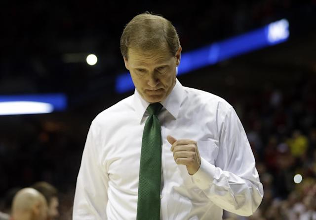 Oregon head coach Dana Altman looks down as he walks off the court after a third-round game against Wisconsin in the NCAA college basketball tournament Saturday, March 22, 2014, in Milwaukee. Wisconsin won 82-77.(AP Photo/Morry Gash)