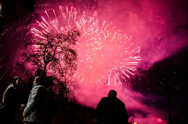 <p>Fireworks explode over the Bulgarian border town of Svilengrad, which is located some 260 km east the capital of Sofia, and some 15 km the Kapitan Andreevo border crossing point with Turkey, during New Year's eve on January 1, 2018. A lot of people gathered to celebrate New Year, Svilengrad, Bulgaria on January 1, 2018. (Photo: Hristo Rusev/NurPhoto via Getty Images) </p>