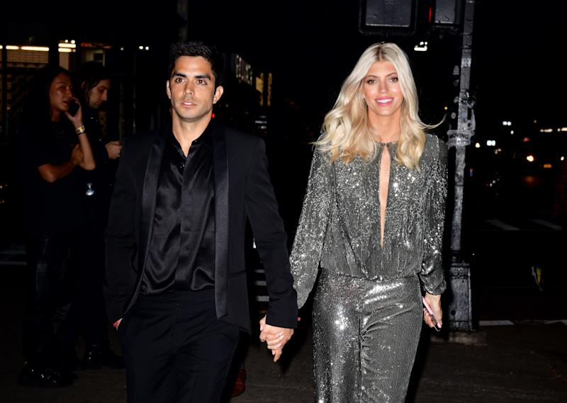 """""""When you think you're flying into a photoshoot and then you look down and see this,"""" Devon Windsor captioned the stunningly picturesque Instagram of the words """"MARRY ME?"""" spelled out onto a beach that she apparently saw out the window in June, effectively announcing her engagement to her longtime, low-key boyfriend, Johnny Dex."""