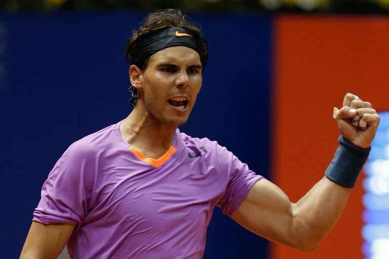 Spanish tennis player Rafael Nadal celebrates after defeating Argentinian Carlos Berlocq during the Brazil Open at Ibirapuera gymnasium in Sao Paulo, Brazil, on February 15, 2013. The 26-year-old Spaniard, ranked number five in the world, won 3-6, 6-4, 6-4 in two hours 24 minutes against the 30-year-old Argentine, ranked 78th in the world