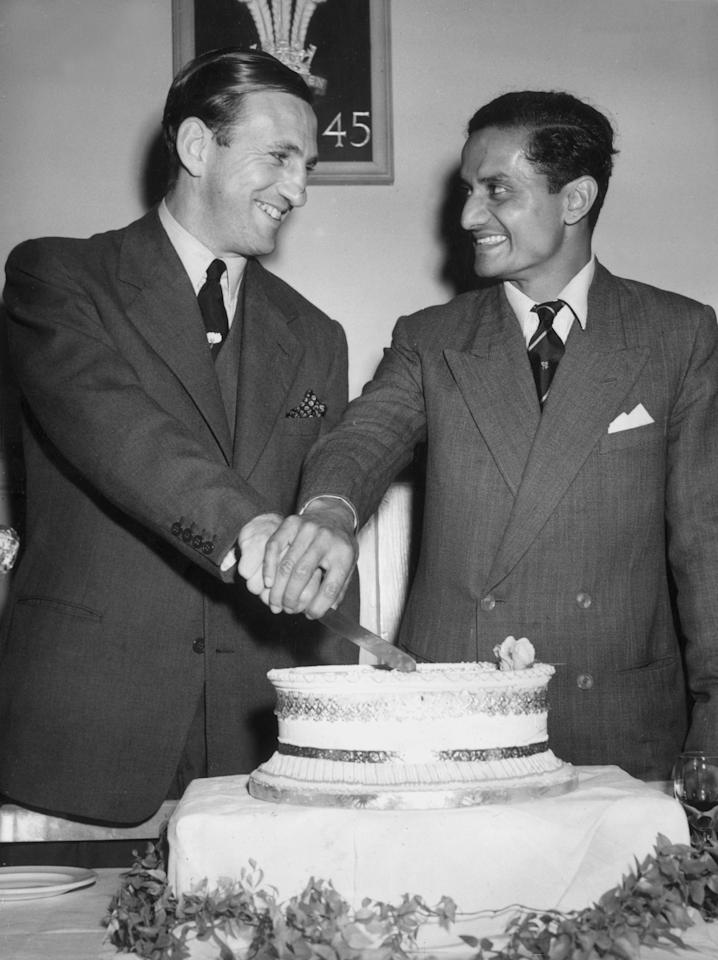 19th August 1952:  Cricket captains Len Hutton and Vijay Hazare cutting the cake during a party held in the Oval following the abandonment of the final Test Match between England and India.  (Photo by Dennis Oulds/Central Press/Getty Images)