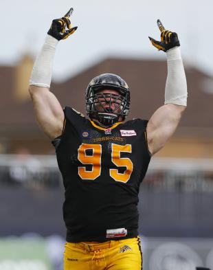 Hamilton Tiger-Cats' Brian Bulcke celebrates a sack against the Saskatchewan Roughriders during the first half of their CFL football in Hamilton, September 14, 2014. REUTERS/Mark Blinch (CANADA - Tags: SPORT FOOTBALL)