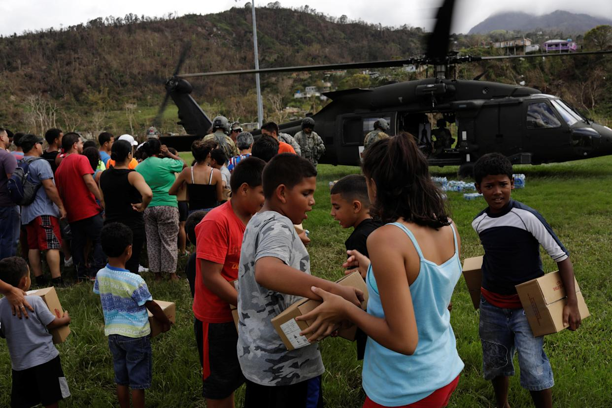 Puerto Rico Residents take relief supplies delivered by soldiers working with a 101st Airborne Division unit on Oct. 5. (Photo: Lucas Jackson/Reuters)