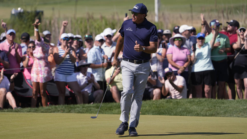 Phil Mickelson reacts to his birdie putt on the seventh green during the final round at the PGA Championship golf tournament on the Ocean Course, Sunday, May 23, 2021, in Kiawah Island, S.C. (AP Photo/David J. Phillip)