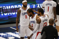 Los Angeles Clippers forward Marcus Morris Sr. (8) and guard Paul George (13), right, congratulate forward Kawhi Leonard (2) after they defeated the Dallas Mavericks in Game 6 of an NBA basketball first-round playoff series in Dallas, Friday, June 4, 2021. (AP Photo/Michael Ainsworth)