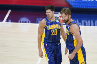 Indiana Pacers' Doug McDermott (20) and Domantas Sabonis (11) react during the first half of the team's NBA basketball Eastern Conference play-In game against the Charlotte Hornets, Tuesday, May 18, 2021, in Indianapolis. (AP Photo/Darron Cummings)