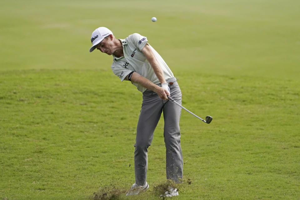 Will Zalatoris kicks up some turf as he hits his approach shot on the ninth hole of his second round of the Sanderson Farms Championship golf tournament in Jackson, Miss., Friday, Oct. 1, 2021. (AP Photo/Rogelio V. Solis)