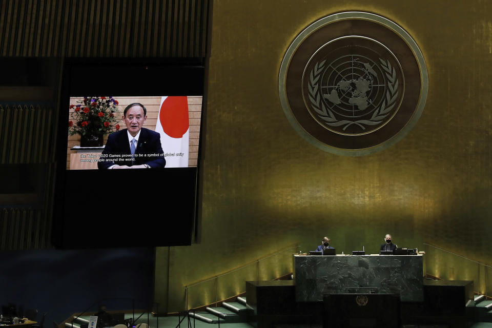 Suga Yoshihide, Prime Minister of Japan, remotely addresses the 76th session of the United Nations General Assembly in a pre-recorded message, Friday Sept. 24, 2021, at UN headquarters. (Peter Foley/Pool Photo via AP)