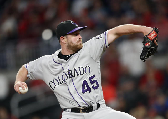 Colorado Rockies relief pitcher Scott Oberg (45) works in the eighth inning of a baseball game against the Atlanta Braves, Friday, April 26, 2019, in Atlanta. (AP Photo/John Bazemore)