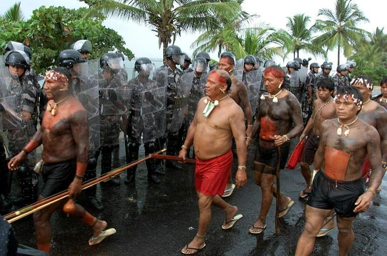 """Members of the Yanomami tribe are seen here at a march in Coroa Vermelha, Brazil in 2000 -- Covid-19 is spreading """"out of control"""" on the tribe's reservation in the country"""