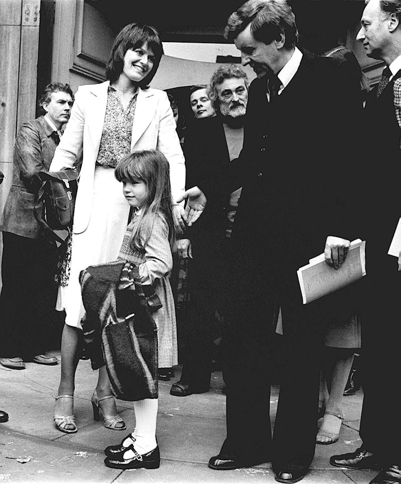 Actress Judy Loe (left), widow of actor Richard Beckinsale and their five year old daughter Katy, receive condolences from actor Richard Briers and other members of the acting profession, outside the Actors' Church, St. Paul's, Covent Garden after today's Memorial Service for Mr Beckinsale. Richard Beckinsale, boyish star of of TV's Porridge and Rising Damp, died on March 19th, aged 31. (Photo by PA Images via Getty Images)