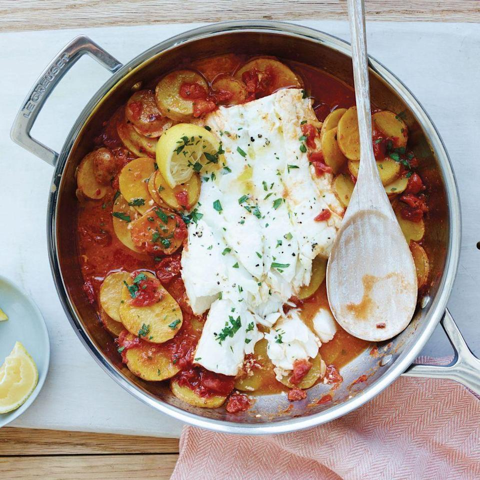 """<p>The tastiest (and easiest) weeknight meal!</p><p>Get the <a href=""""https://www.delish.com/uk/cooking/recipes/a29806790/cod-with-garlicky-tomatoes-and-potatoes-recipe/"""" rel=""""nofollow noopener"""" target=""""_blank"""" data-ylk=""""slk:Cod with Garlicky Tomatoes and Potatoes"""" class=""""link rapid-noclick-resp"""">Cod with Garlicky Tomatoes and Potatoes</a> recipe.</p>"""